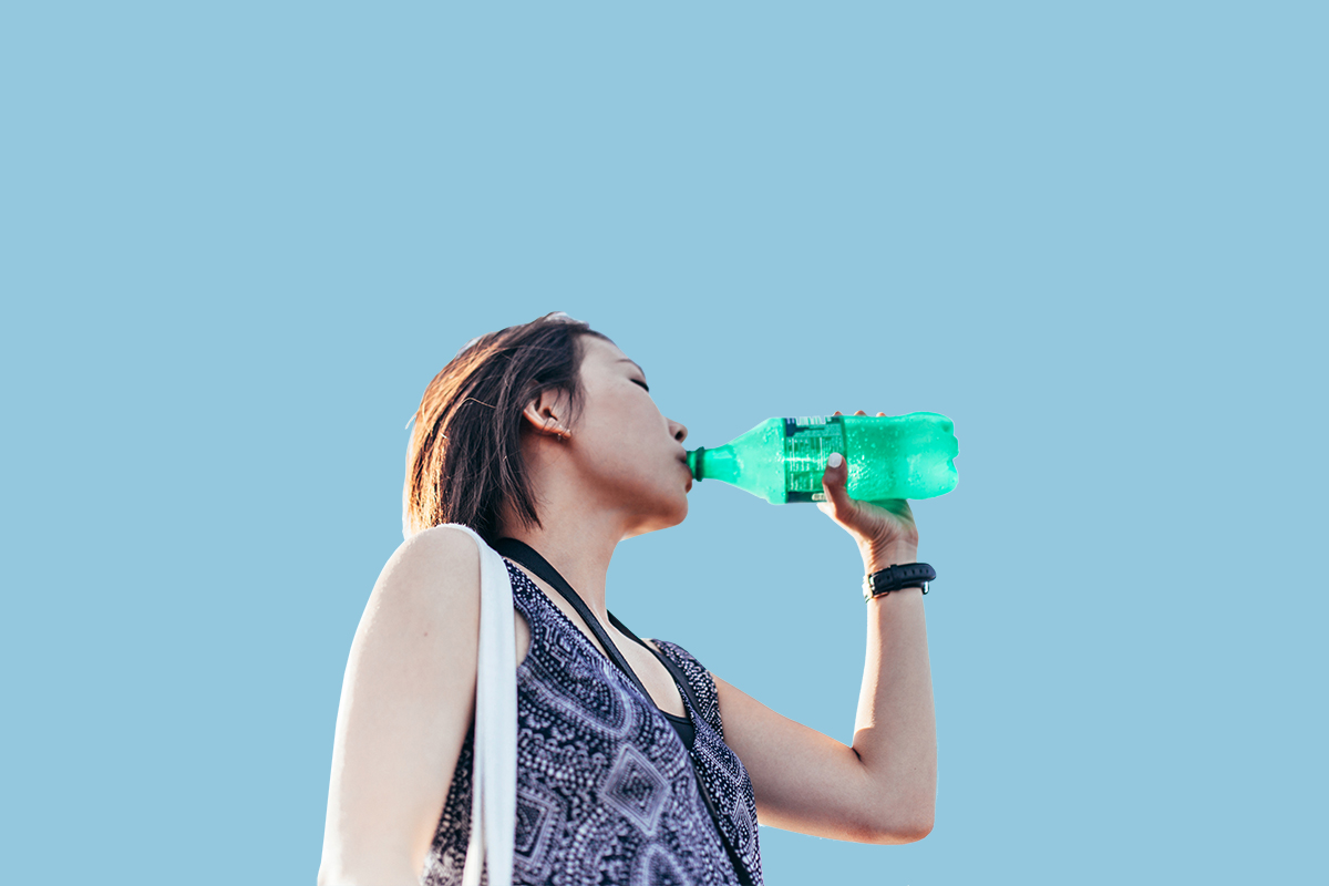Woman with sugary drink