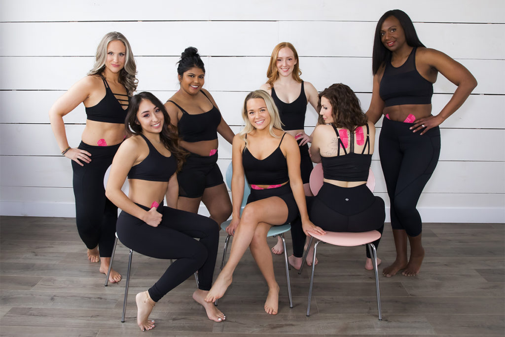 A group of women using mobility tape