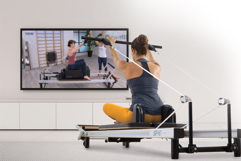 Woman working out with Merrithew Connect