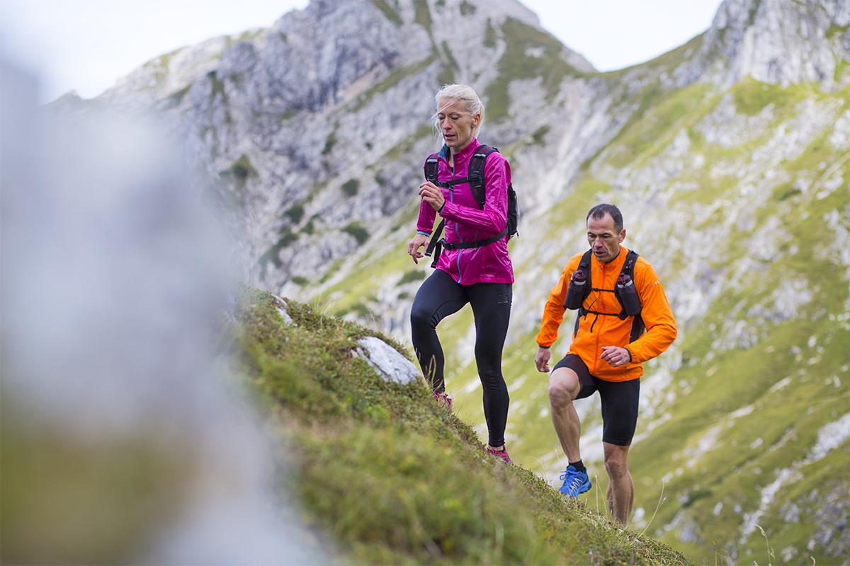 Older athletes hiking outside