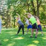 A group of people doing outdoor fitness at a park