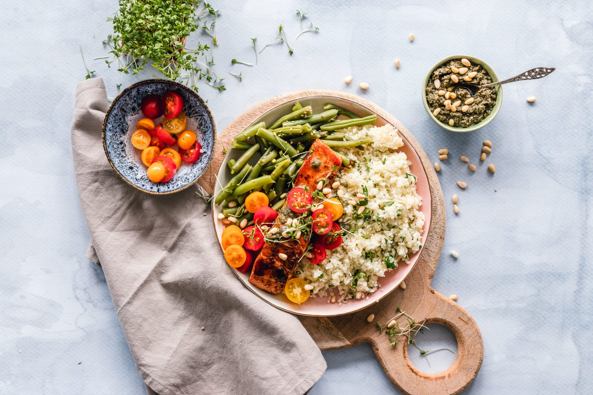 colorful vegetable grain bowl with tomatoes, rice, lentils and herbs