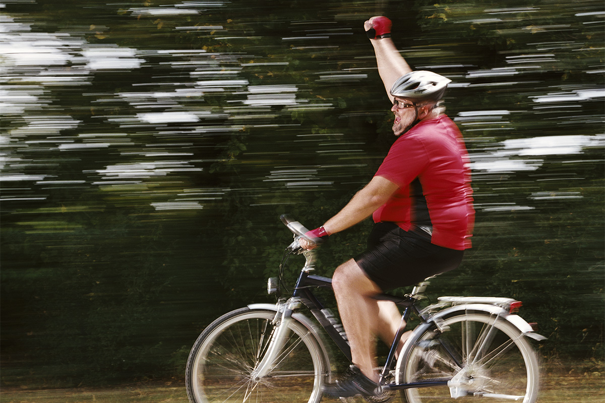 Man on a bike for exercise and liver health