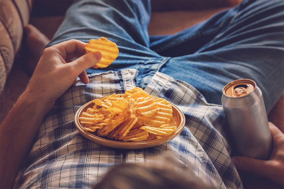 Person snacking on potato chips