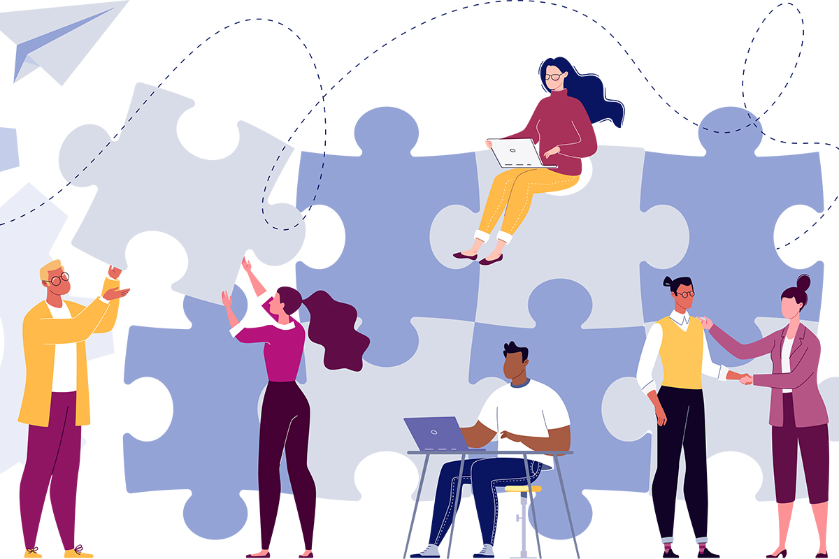 People putting puzzle pieces together to show business collaboration