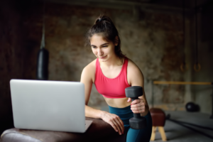 Woman practicing virtual training in fitness hybridization