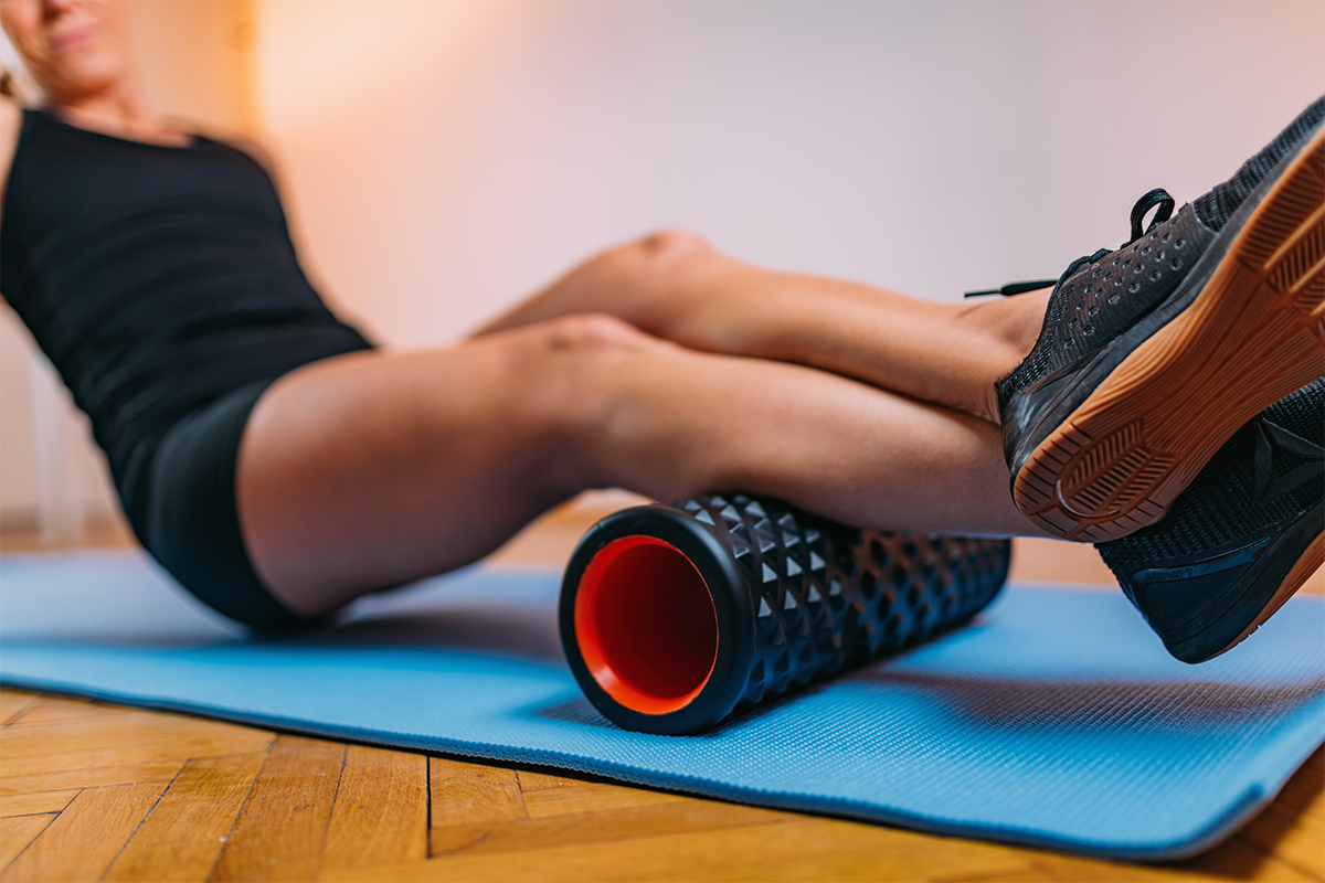A person foam rolling for range of motion