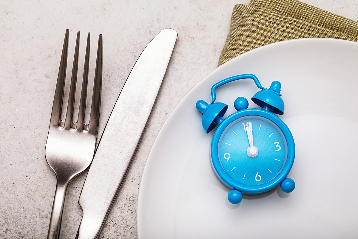 Fork and clock to represent hunger and blood sugar