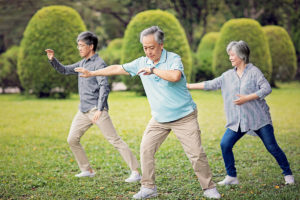 Older adults practicing tai chi for weight loss